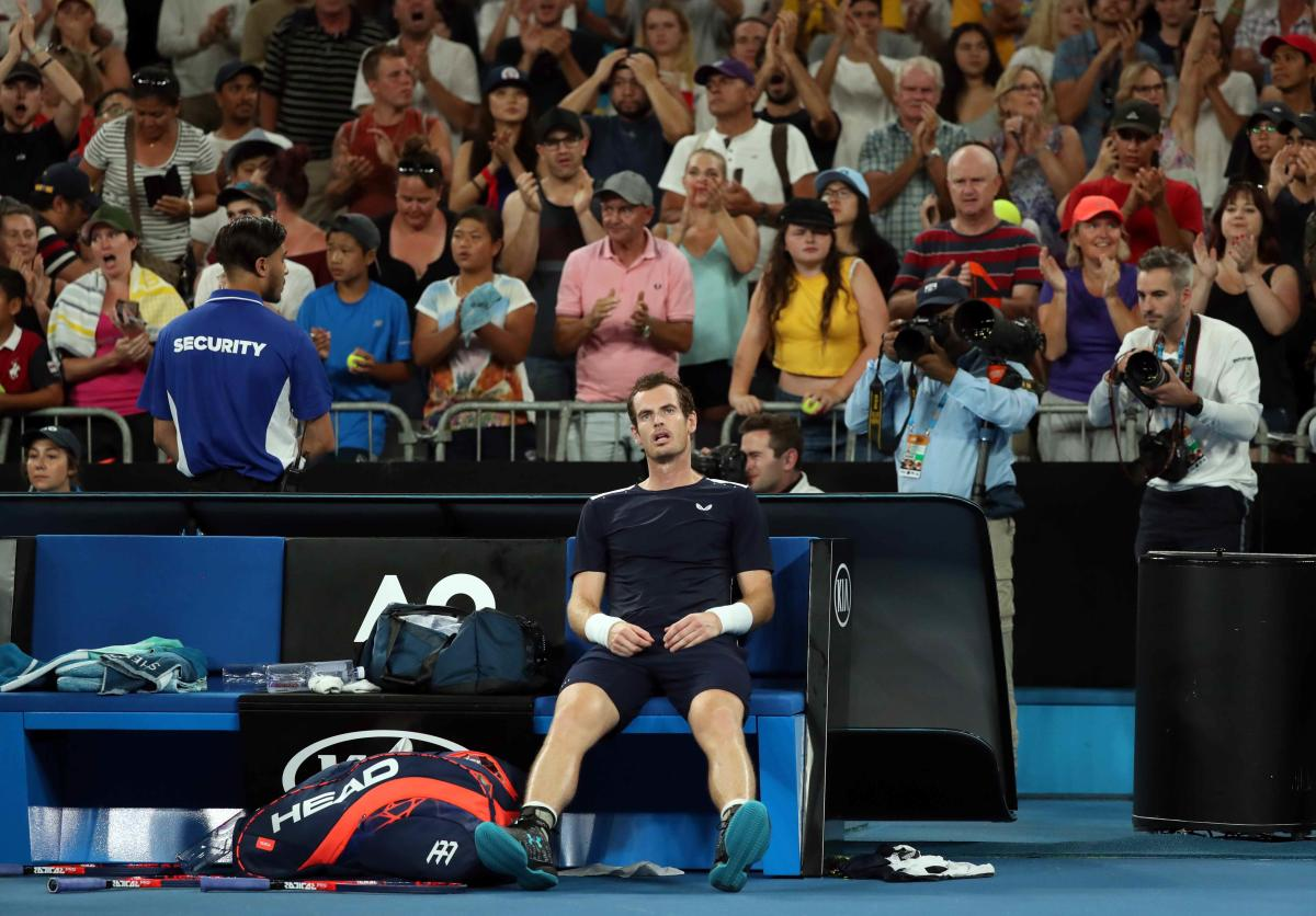 Andy Murray looks dejected after losing the match against Spain's Roberto Bautista Agut. Reuters