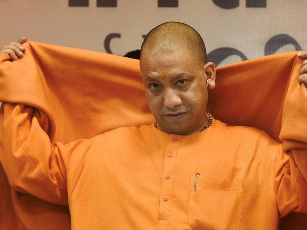 Two separate FIRs-- one for the violence in which nearly 80 people including 27 named and the other for cow slaughter-- were registered at the Siyana Police Station. (Above: UP CM Yogi Adityanath. PTI file photo)