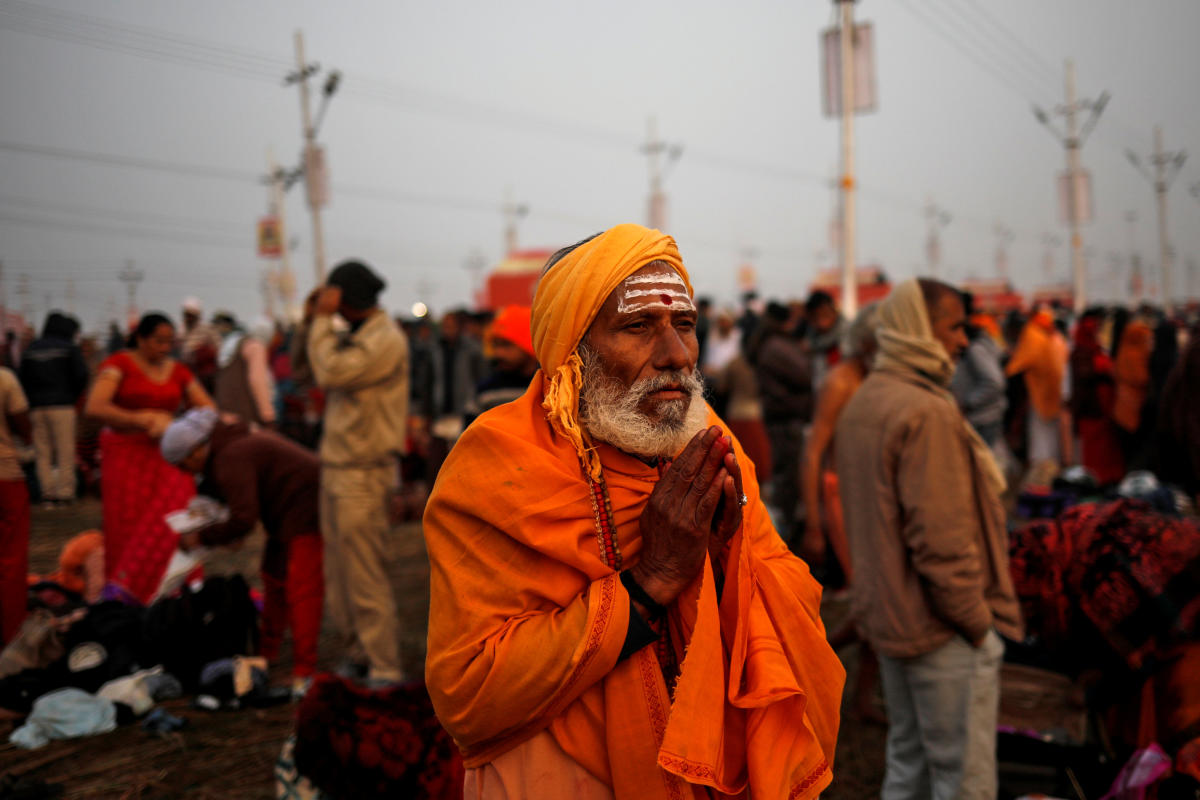 "A devotee prays after taking a holy dip at Sangam, the confluence of the Ganges, Yamuna and Saraswati rivers, during ""Kumbh Mela"", or the Pitcher Festival, in Prayagraj, previously known as Allahabad, India, January 14, 2019. REUTERS"