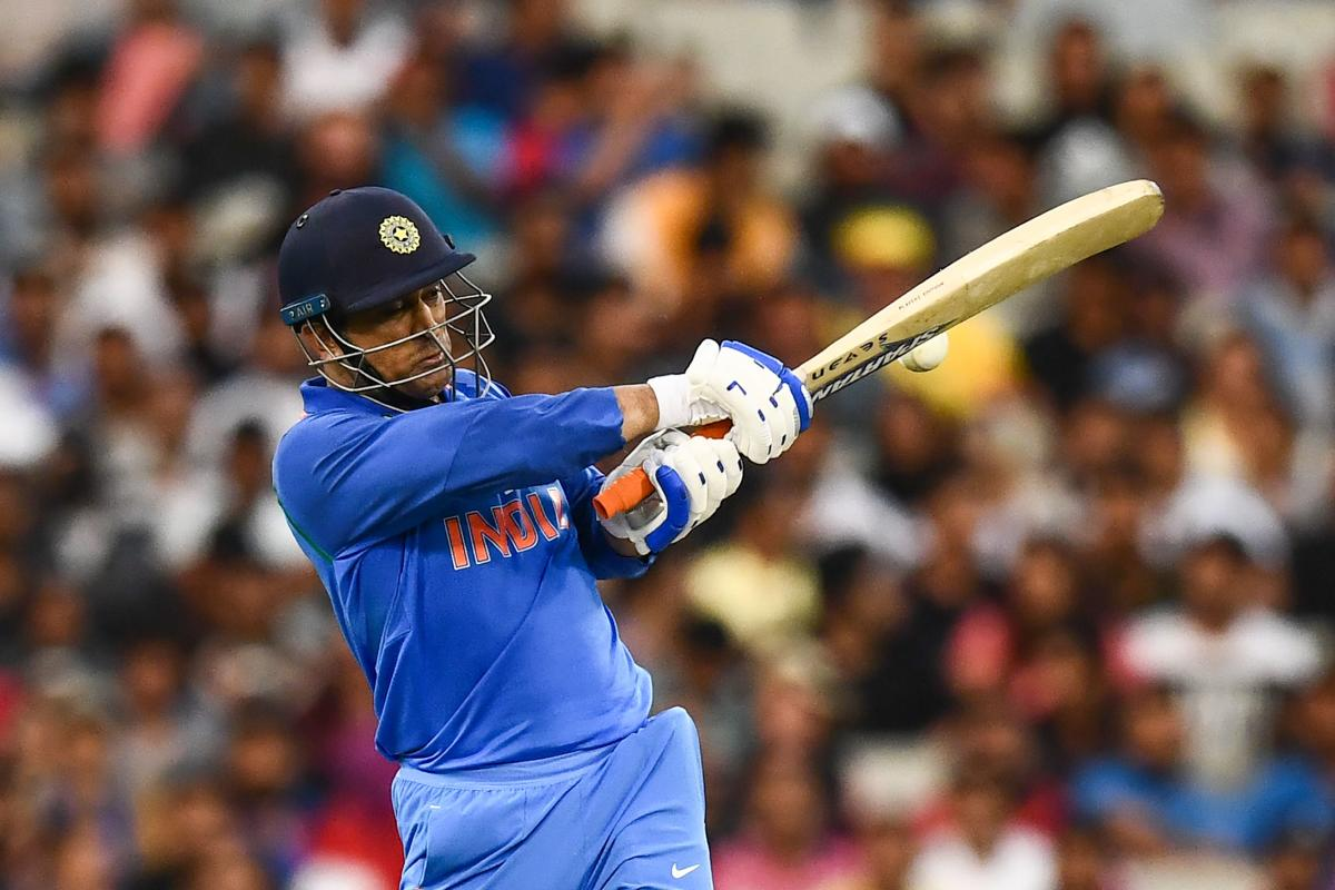 India's Mahendra Singh Dhoni plays a shot during the third one-day international cricket match between Australia and India at the Melbourne Cricket Ground. AFP Photo