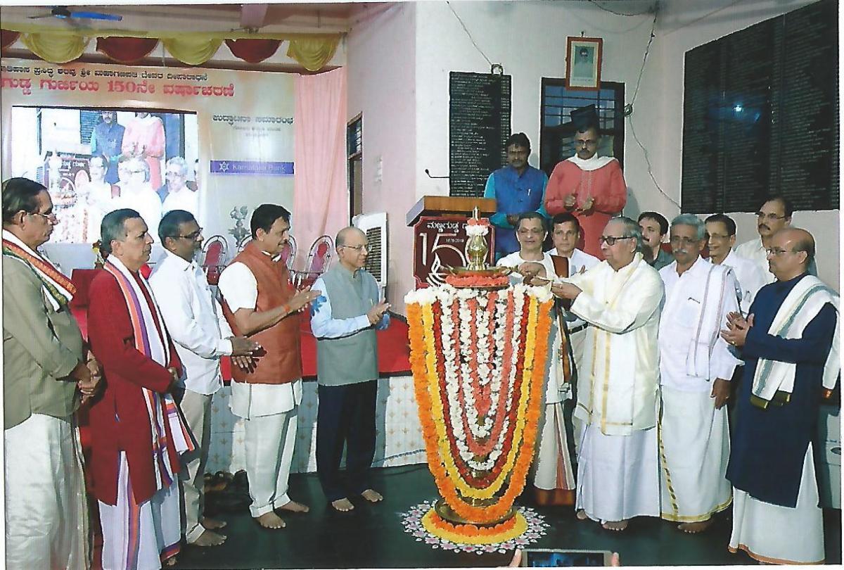 Former advocate general B V Acharya lights a lamp to inaugurate 150th year celebrations of Mannagudde Gurji in Mangaluru.