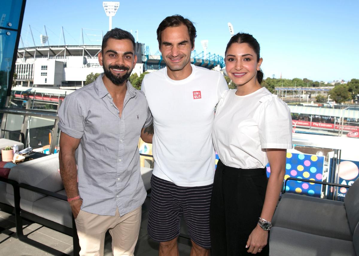 Tennis legend Roger Federer (centre) with Indian cricket skipper Virat Kohli (left) and his actor wife Anushka Sharma at the Rod Laver Arena in Melbourne on Saturday. AFP
