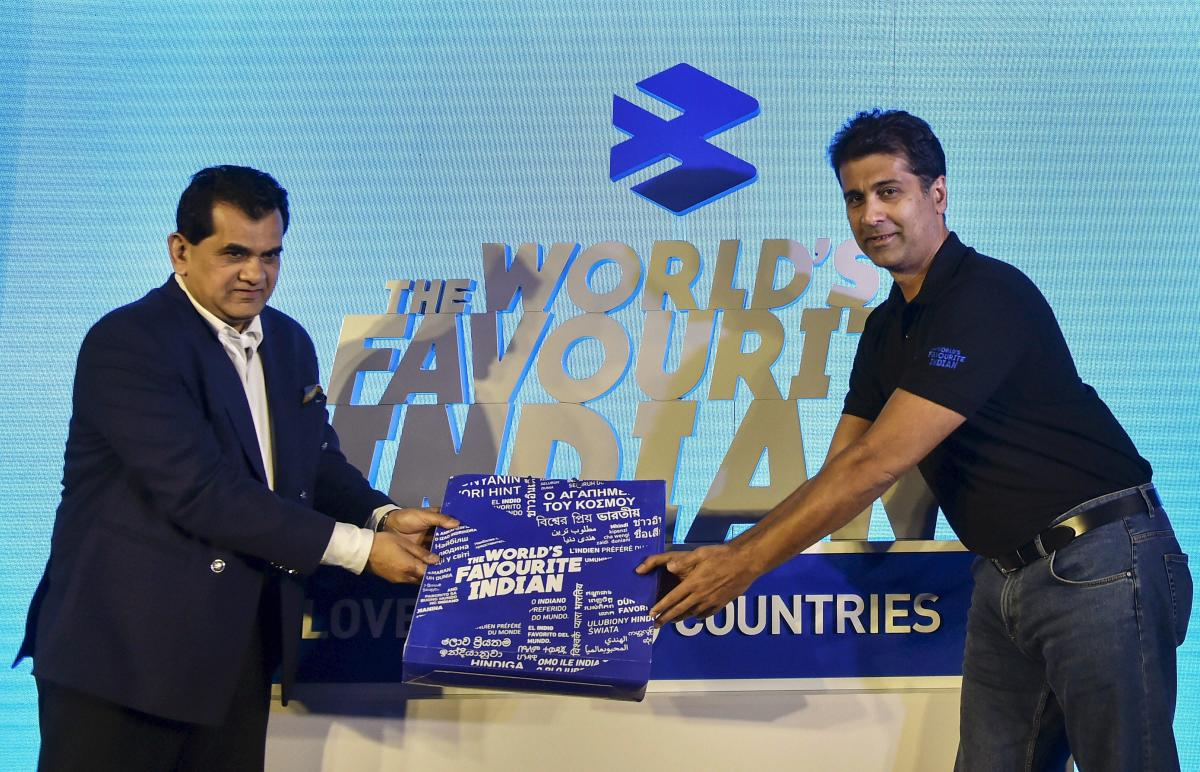 NITI Aayog CEO Amitabh Kant being felicitated by Bajaj Auto MD Rajiv Bajaj during an event, in New Delhi on Monday. PTI