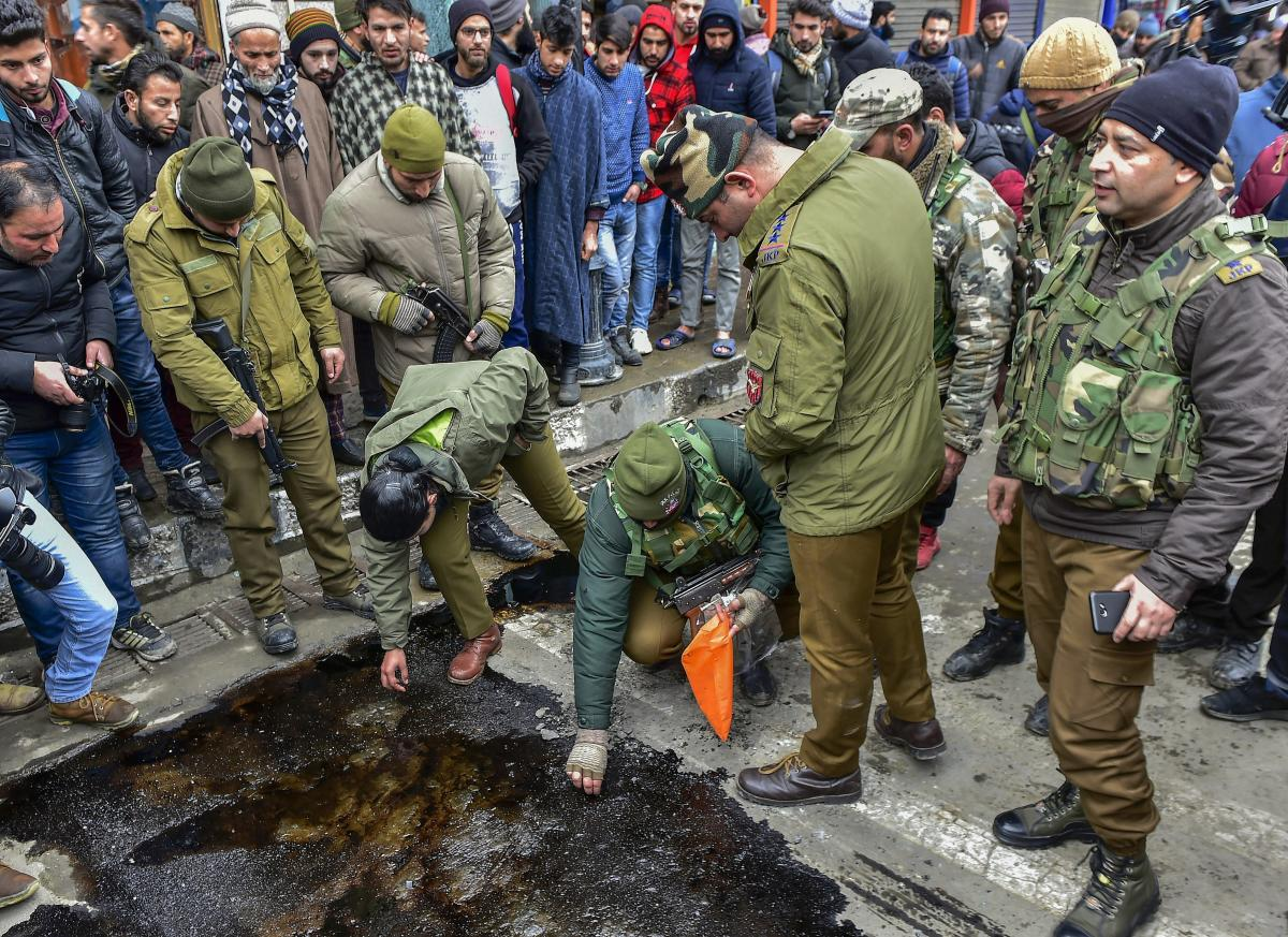 Police personnel collect samples after a grenade attack by militants who were reportedly targeting a CRPF picket, at City Centre Lal Chowk in Srinagar, Friday, Jan 18, 2019. (PTI Photo)