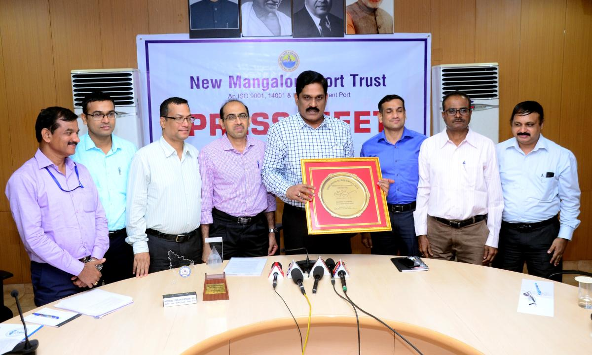 NMPT chairman M T Krishna Babu and other staff members seen with the Swachhata Sarvekshan Award instituted by the Ministry of Shipping for the cleanest port.