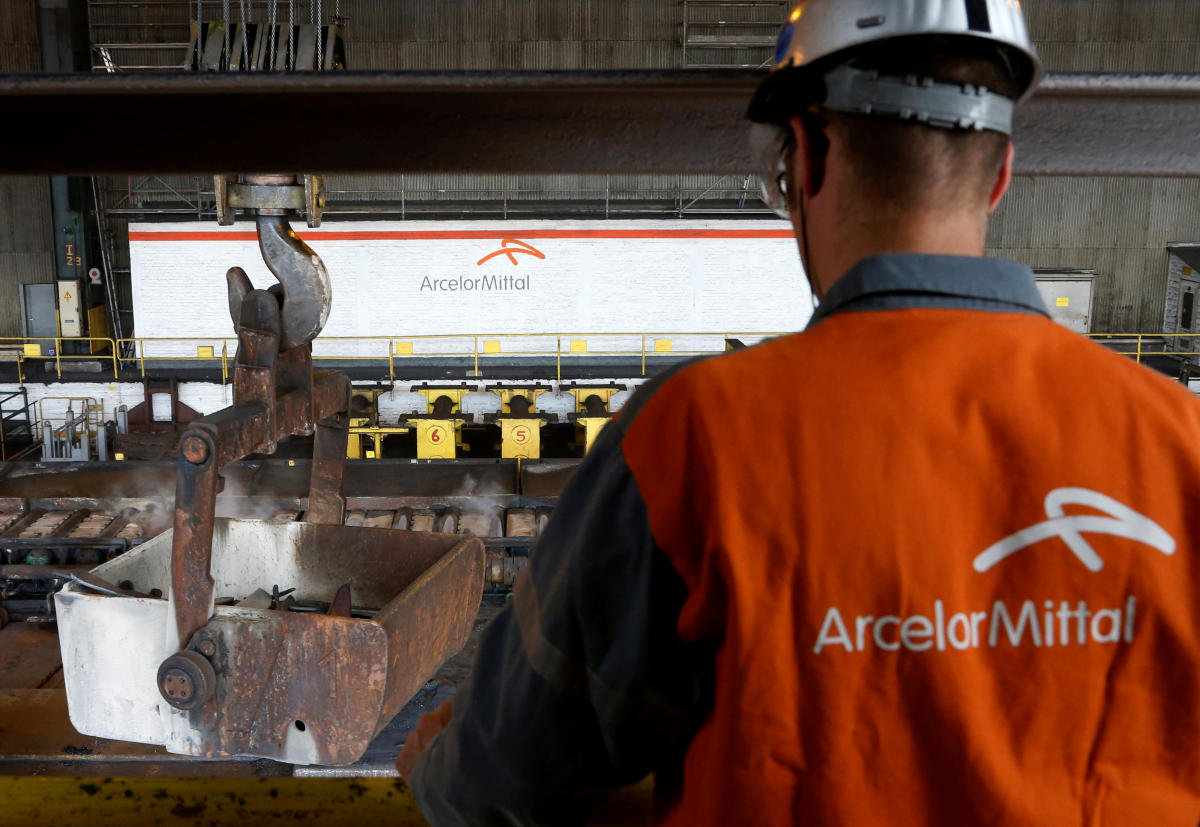 FILE PHOTO: A worker surveys the production process at the ArcelorMittal steel plant in Ghent, Belgium. Reuters
