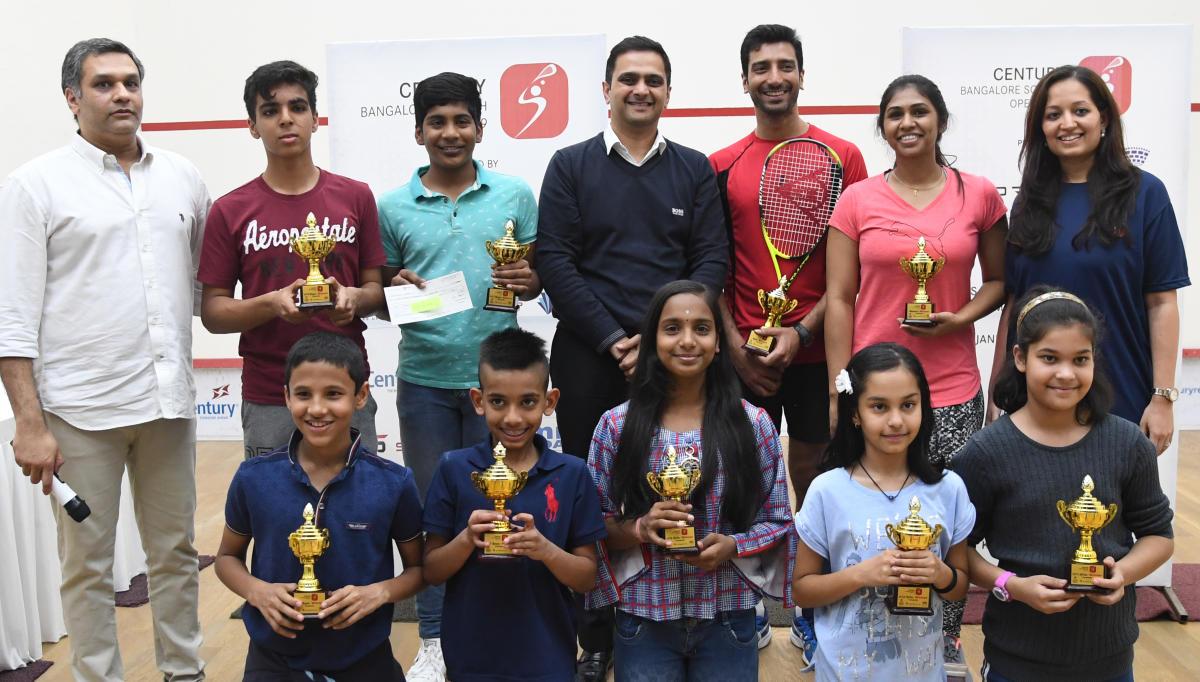 All smiles: Winners of the 5Sports Century Bengaluru Open Squash tournament in Bengaluru on Wednesday. STANDING: FROM LEFT: Jay Javeri (Partner, 5Sports), Ekam Singh (Boys, U-15), Navaneeth Prabhu S (Boys, U-17), Ravi Pai (MD, Century Real Estate), Gaurav