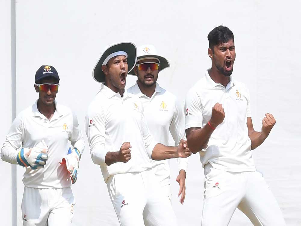 Karnataka bowler Ronit More (right) exults after bagging a Saurashtra wicket during the Ranji Trophy semifinal in Bengaluru on Friday. Picture credit: Srikanta Sharma R/ DH Photo