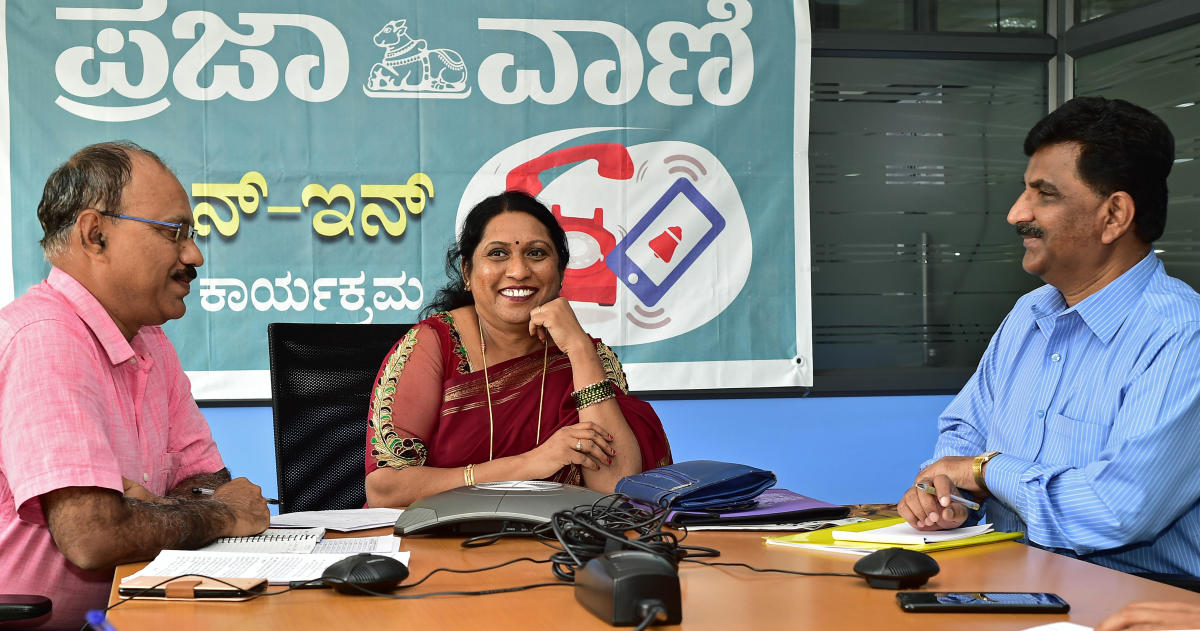 Director of Karnataka Secondary Education Examination Board V Sumangala answers queries during the phone-in programme organised by Prajavani at its office in Bengaluru on Friday. Senior Assistant Directors K M Gangadharaswamy and Shekharappa are seen. DH