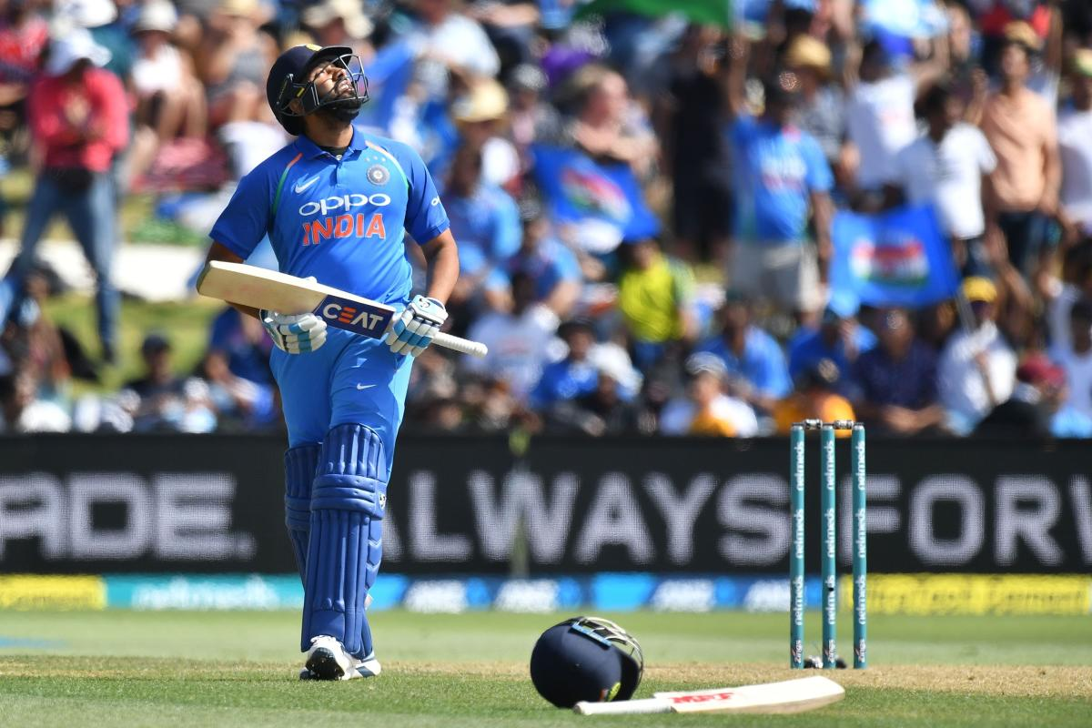 India's Rohit Sharma celebrates reaching his half-century during the second one-day international (ODI) cricket match between New Zealand and India in Tauranga on January 26, 2019. (AFP Photo)