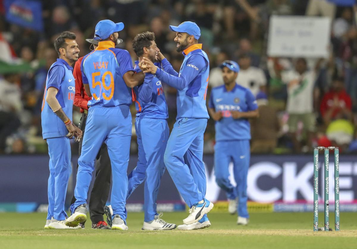 Kuldeep Yadav (centre) of India celebrates during the second one day international between India and New Zealand at Blake Park in Tauranga in New Zealand on Saturday. AP/PTI Photo