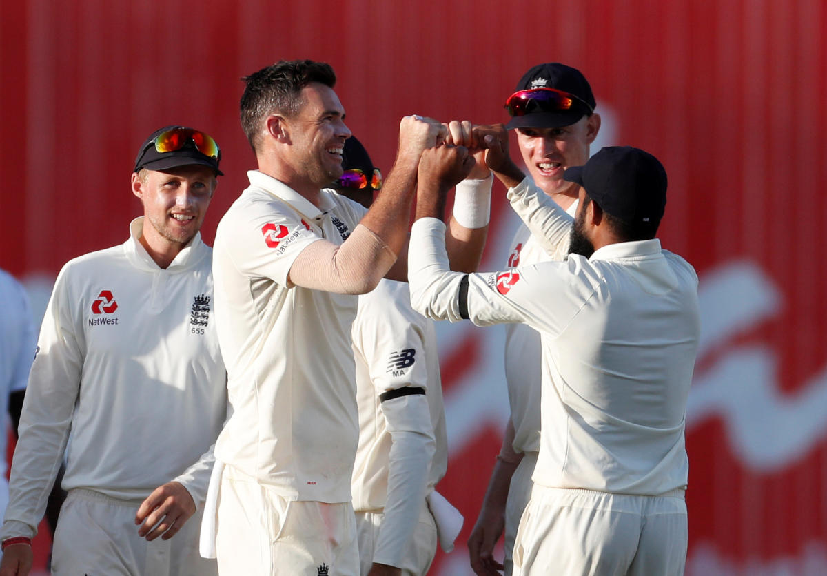 LATE CHARGE: England's James Anderson (second from left) celebrates with team-mates after dismissing West Indies' Jason Holder on Wednesday. Reuters