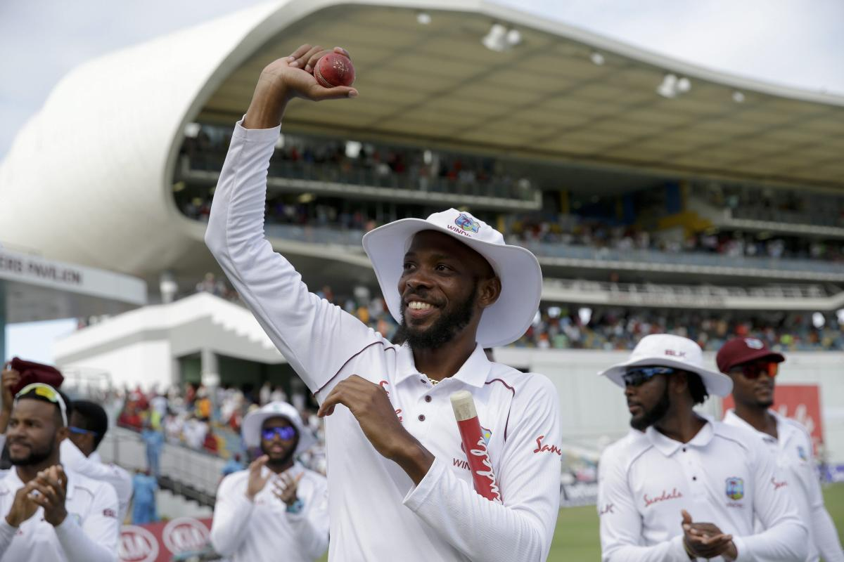 Roston Chase celebrates after bowling West Indies to victory in the first Test against England in Bridgetown, Barbados, on Saturday.