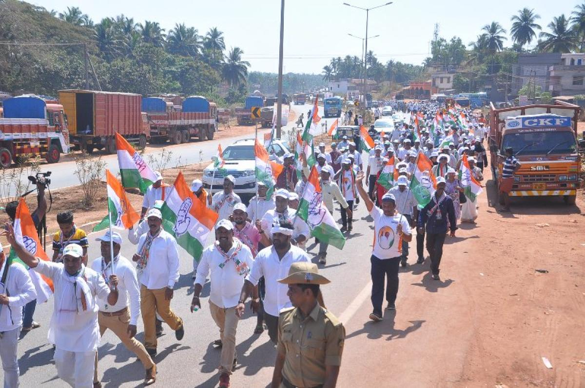 Congress workers take out a padayatra from Talapady to Pumpwell on Monday.