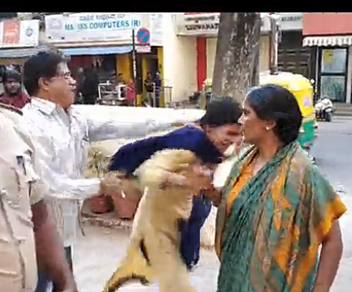 (left to right) Video grab showing ASI Renukaiah assaulting Saraswathi and her mother Rajeshwari at the police station.