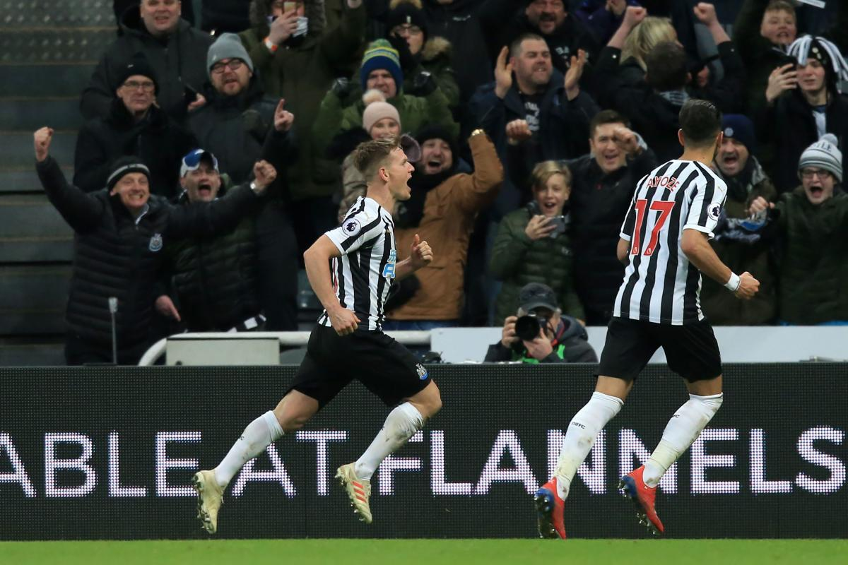 Newcastle United's Scottish midfielder Matt Ritchie (L) celebrates after scoring their second goal from the penalty spot during the English Premier League football match between Newcastle United and Manchester City at St James' Park in Newcastle-upon-Tyne