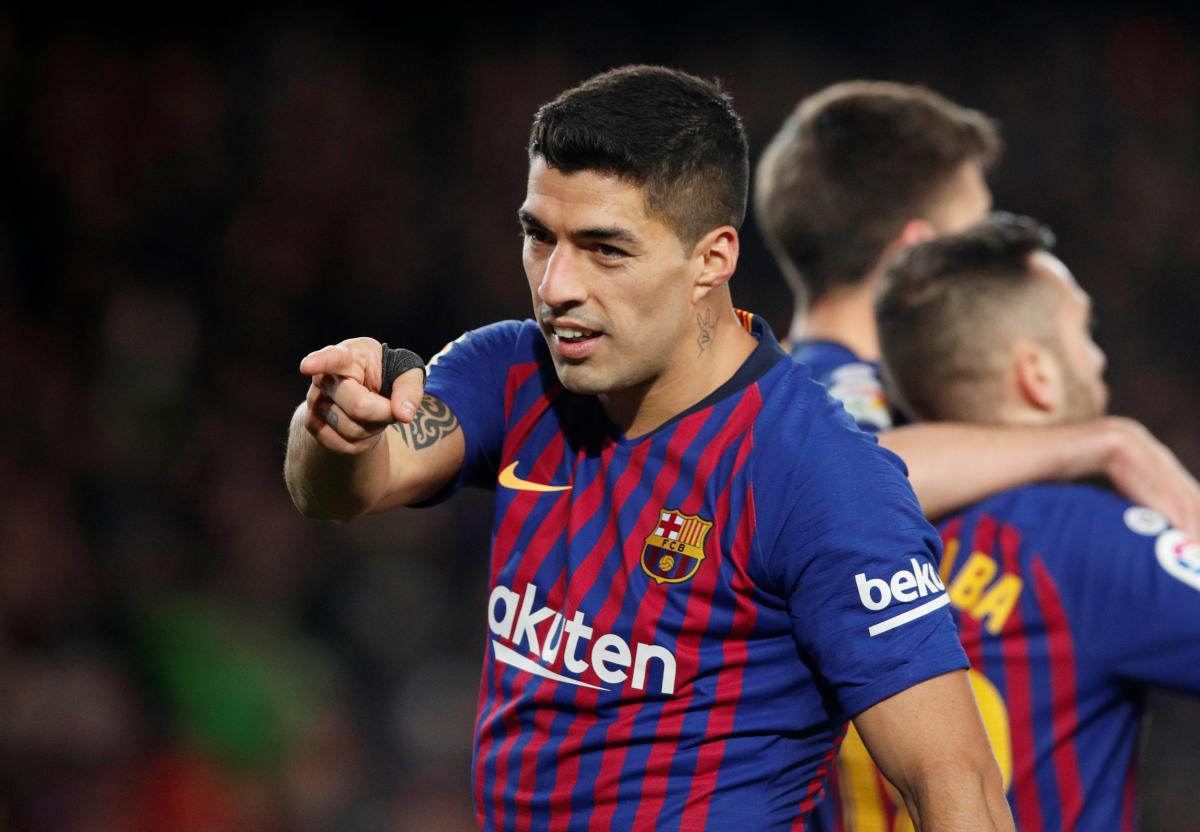 GOAL-FEST Barcelona's Luis Suarez celebrates after scoring against Sevilla during their Copa del Rey quarterfinal clash on Wednesday. REUTERS