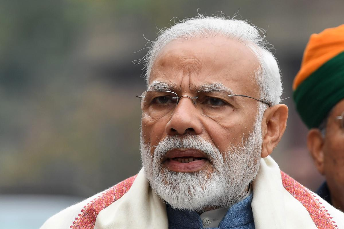 Prime Minister Narendra Modi addresses the media after his arrival at parliament for a budget session in New Delhi. AFP.