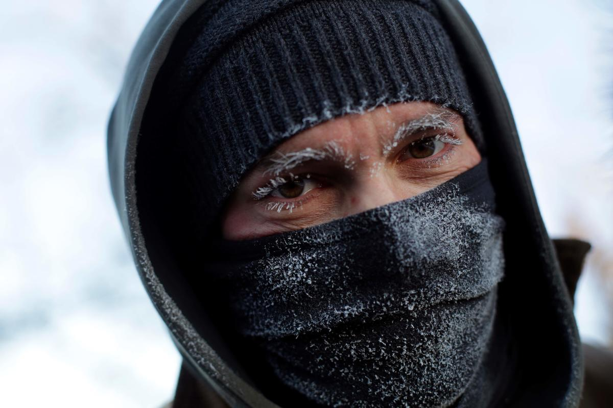 A man's eyebrows and eye lashes are frozen as temperatures dropped to -29 degrees C on January 30, 2019 in Chicago, Illinois. AFP