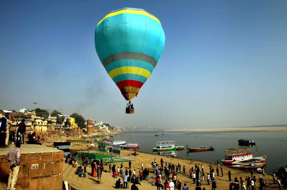 Tourists enjoy hot-air hot-air balloon rides above the historic Assi ghat in Varanasi. PTI file photo