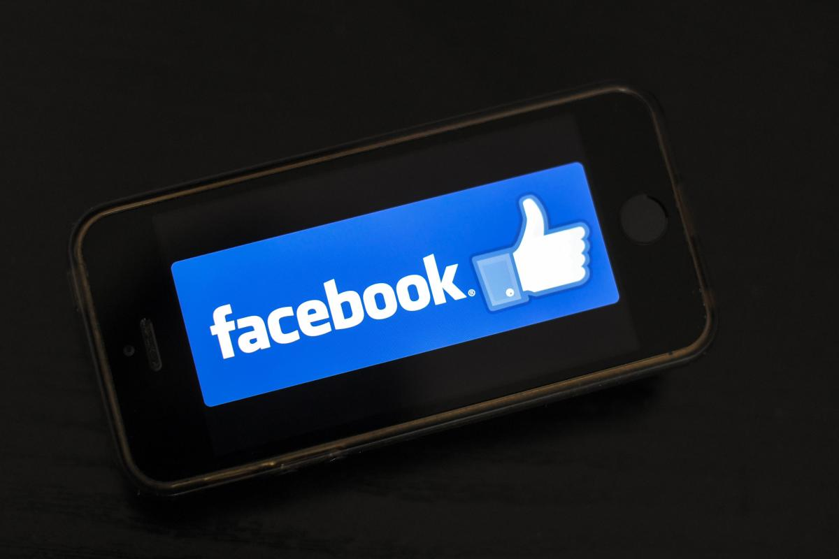 File photo: The logo of social network Facebook is displayed on a smartphone.