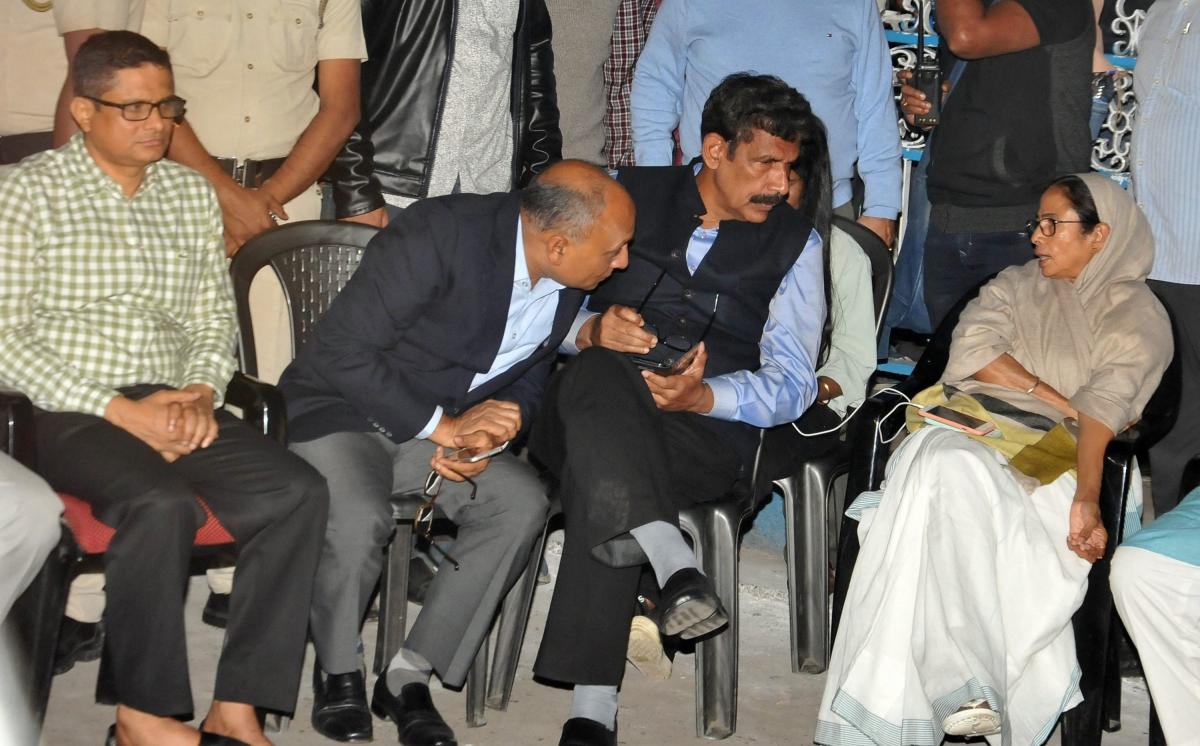West Bengal Chief Minister Mamata Banerjee sitting on her 'Save the Constitution' dharna after CBI raids Kolkata Police Commissioner's residence in Kolkata, Sunday late evening, Feb 03, 2019. Kolkata Police Commissioner Rajeev Kumar (L) is also seen. (PTI
