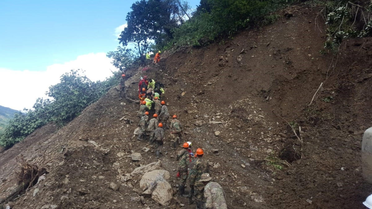 Soldiers and members of a rescue team are seen after a landslide due to heavy rains near Caranavi in La Paz Department, Bolivia