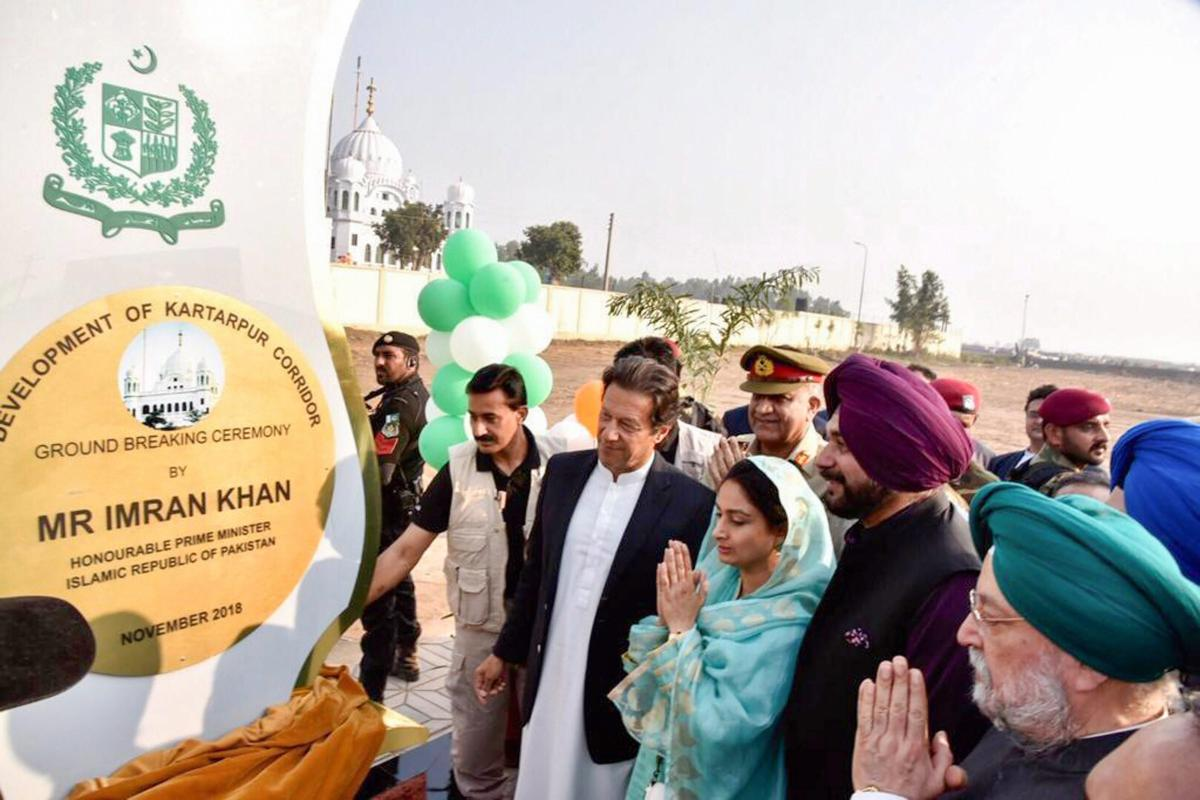 Pakistan's Prime Minister Imran Khan, cricketer-turned-Indian politician Navjot Singh Sidhu, Minister for Food Processing Industries Harsimrat Kaur Badal during ground breaking ceremony for Kartarpur corridor in Pakistan's Kartarpur, Wednesday, Nov. 28, 2