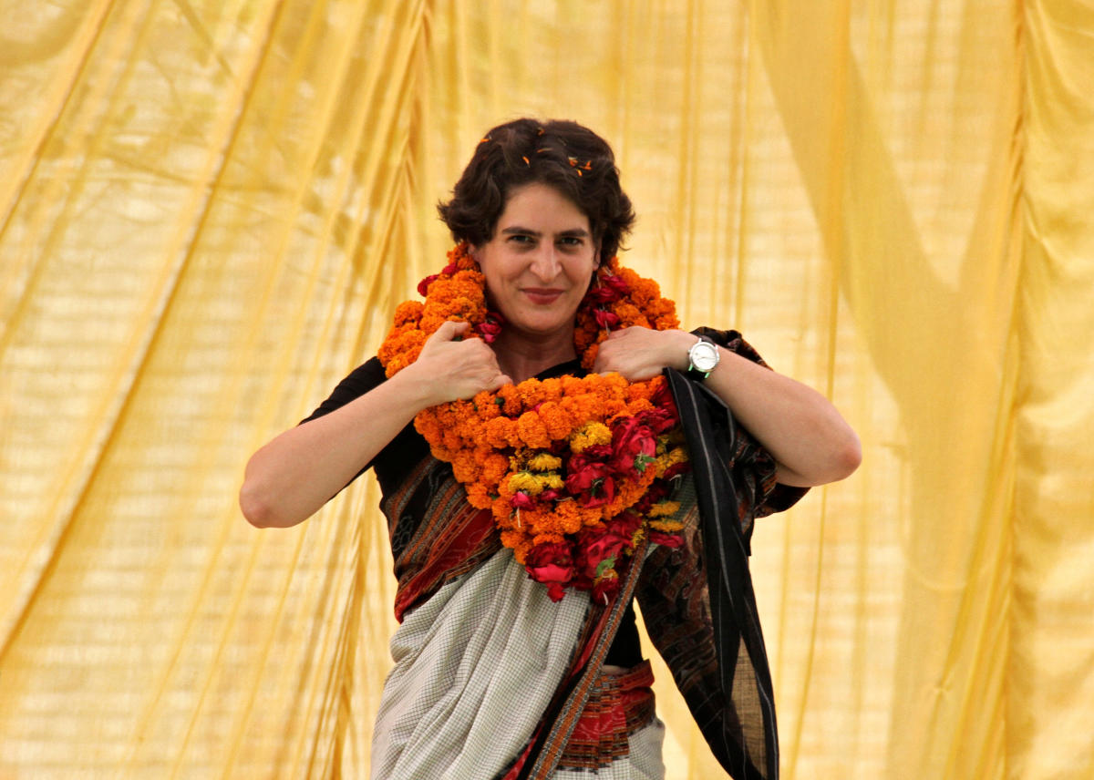 FILE PHOTO: Priyanka Gandhi Vadra, daughter of India's ruling Congress party chief Sonia Gandhi, adjusts her flower garlands as she campaigns for her mother during an election meeting at Rae Bareli.