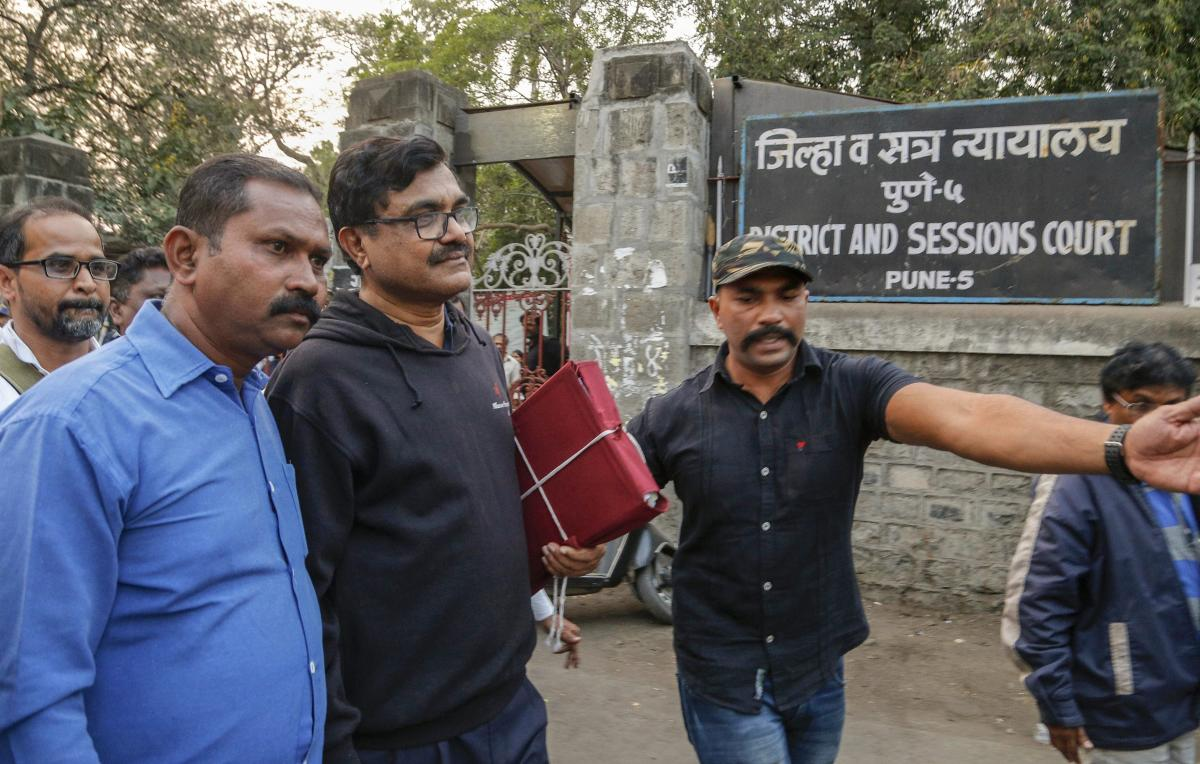 Activist Anand Teltumbde (wearing black pullover) leaves after Pune District and Sessions Court released him in Bhima Koregaon case, in Pune, February 2, 2019. (PTI Photo)