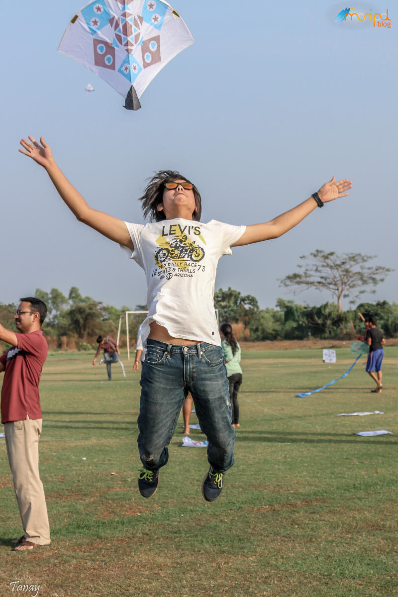A student releases a kite 'Tarang', annual Kite Festival held at End Point in Manipal.