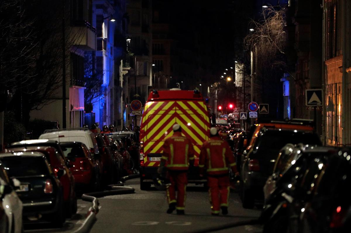 Firefighters are seen near a building that caught fire in the 16th arrondissement in Paris. AFP.