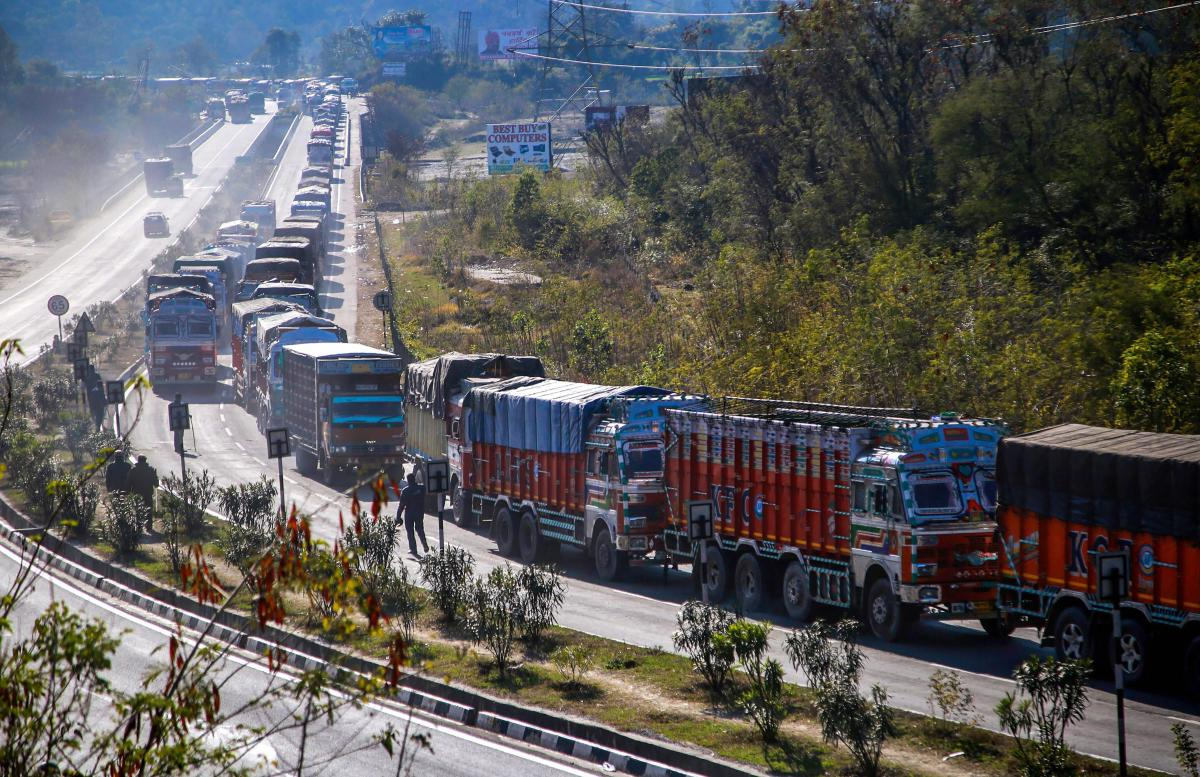 Stranded trucks wait for the opening of the Jammu-Srinagar national highway. PTI file photo