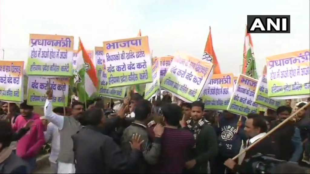 Amidst speculation that the BJP is indulging in Operation Lotus, Congress workers staged a protest infront of luxury hotel near Gurugram where nearly 100 BJP MLA are staying for the past two days on Wednesday morning. ANI photo