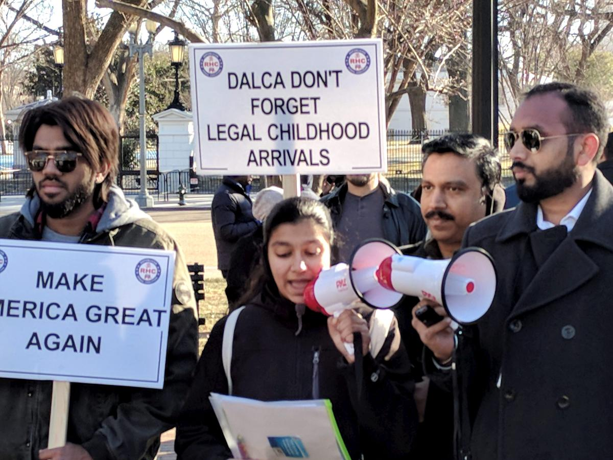 Highly-skilled Indian workers hold a rally to end the per-country limit on legal permanent residency so as to eliminate the massive Green Card backlog, in front of the White House in Washington. PTI file photo.