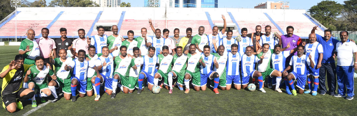 Former ITI and HAL players before their clash at the Bangalore Football Stadium on Saturday. DH photo