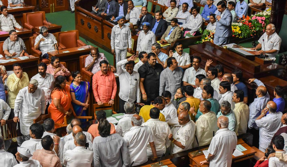 BJP members stage protests in the Assembly (left) and the Council during the session at the Vidhana Soudha in Bengaluru on Thursday. dh photo