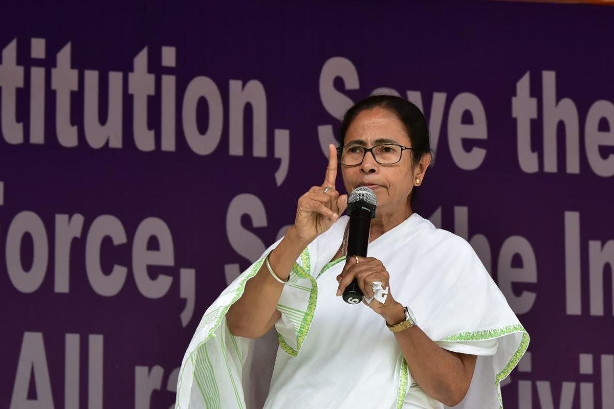West Bengal Chief Minister and All India Trinamool Congress leader Mamata Banerjee speaks during a protest against the recent raids by India's Central Bureau of Investigation (CBI), in Kolkata on February 5, 2019. (Photo by STR / AFP)