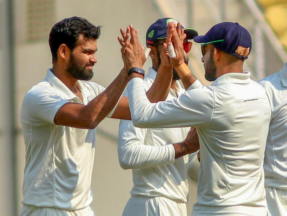KEY MAN: The in-form left-arm spinner Aditya Sarwate (left) of Vidarbha will be a major threat to Rest of India in the Irani Cup. PTI File Photo