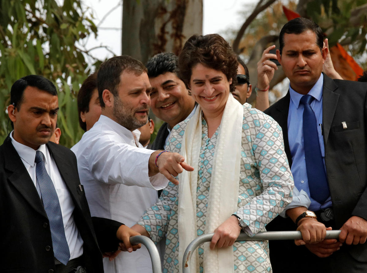 Rahul Gandhi, President of Congress party, flanked by his sister and a leader of the party Priyanka Gandhi Vadra, gestures during a roadshow in Lucknow. Reuters