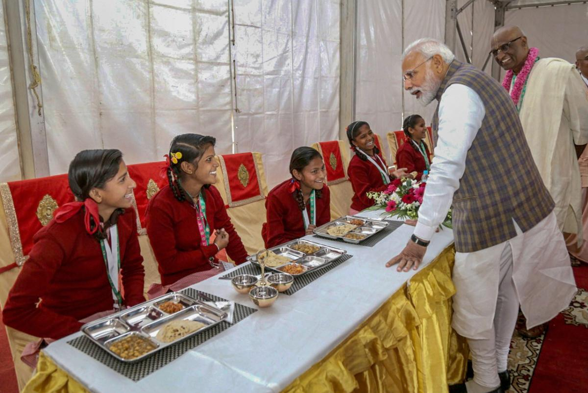Prime Minister Narendra Modi serves food to underprivileged children during a programme organised to mark the serving of the 3rd billionth meal by the Akshaya Patra Foundation, in Vrindavan near Mathura, on Monday. PTI