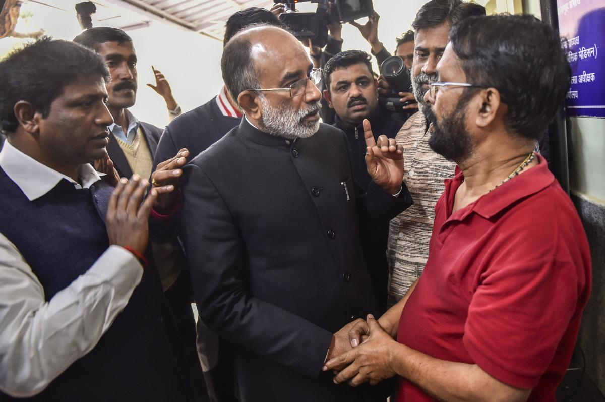 Union Tourism Minister Alphons Joseph Kannanthanam meets a relative of a Karol Bagh fire victim, at Ram Manohar Lohia Hospital in New Delhi, Tuesday, Feb 12, 2019. (PTI Photo)