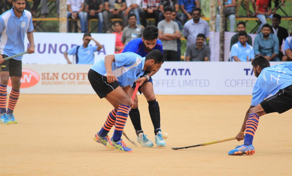 A file photograph of an exhibition match between Indian Olympian and Coorg International teams.