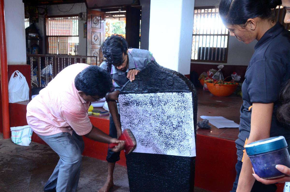Experts' team collect imprint of an inscription found at Sri Veeranarayana Temple in Kulashekar.