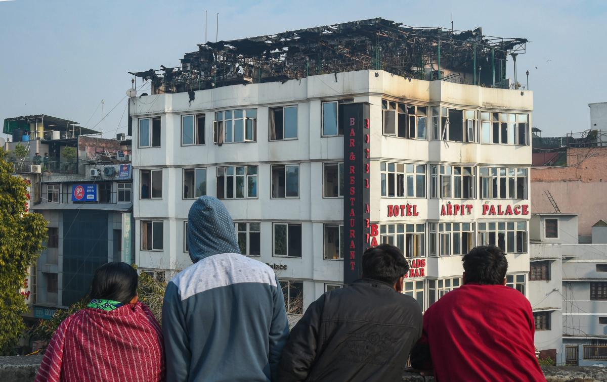 People look on at Karol Bagh's Hotel Arpit Palace where a massive fire broke out, in New Delhi, Tuesday, Feb. 12, 2019. At least 17 people were killed and several others were injured in the accident. (PTI Photo)
