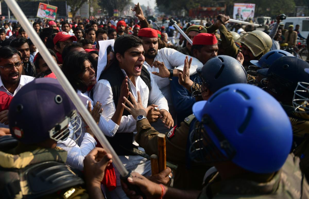 Indian policemen scuffle with Samajwadi Party activist during a protest after their party chief Akhilesh Yadav was stopped from boarding a plane at Lucknow airport, in Allahabad on February 12, 2019. (AFP Photo)