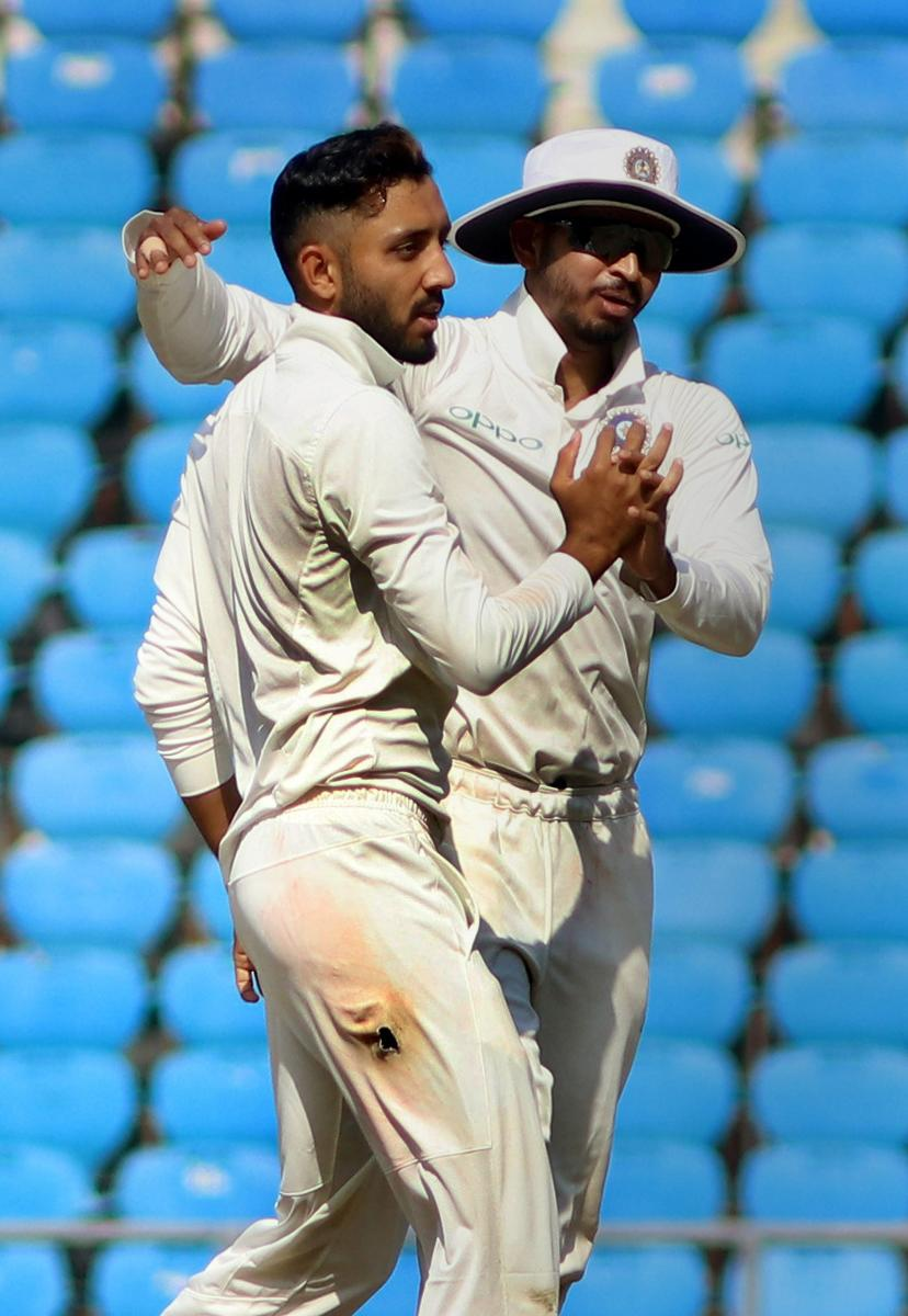 Rest of India bowler Dharmendrasinh Jadeja (left) celebrates the dismissal of Vidarbha batsman Ganesh Satish on the second day of the Irani Cup in Nagpur on Wednesday. PTI