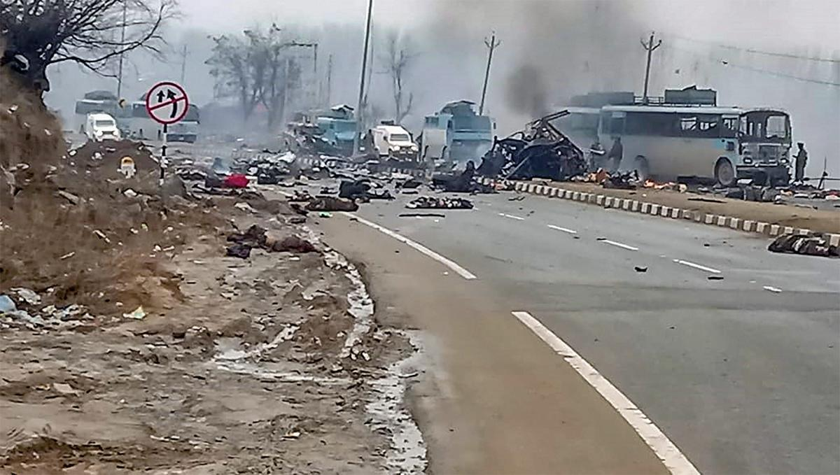 Awantipora: A scene of the spot after militants attacked a CRPF convoy in Goripora area of Awantipora town in Pulwama district, Thursday, Feb 14, 2019. At least 18 CRPF jawans were reportedly killed in the attack. (PTI Photo)