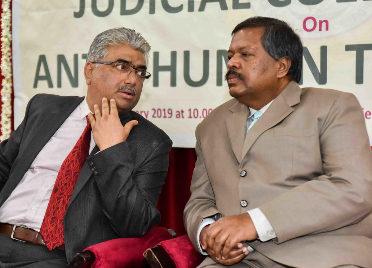 High Court Chief Justice L Narayana Swamy speaks with High Court Judge Arvind Kumar on the seminar with judicial officials on the Karnataka Law Services Authority and the High Court Legal Services Committee on Sunday.