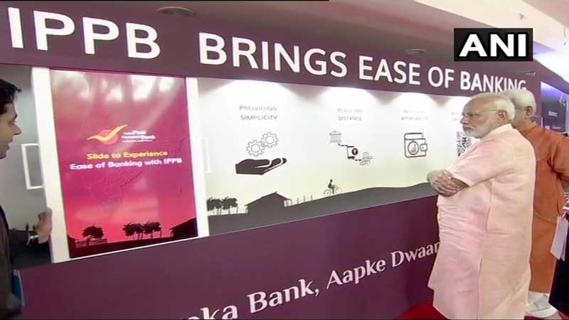 Prime Minister Narendra Modi at an exhibition ahead of launch of India Post Payments Bank (IPPB) in Delhi. (ANI/Twitter)